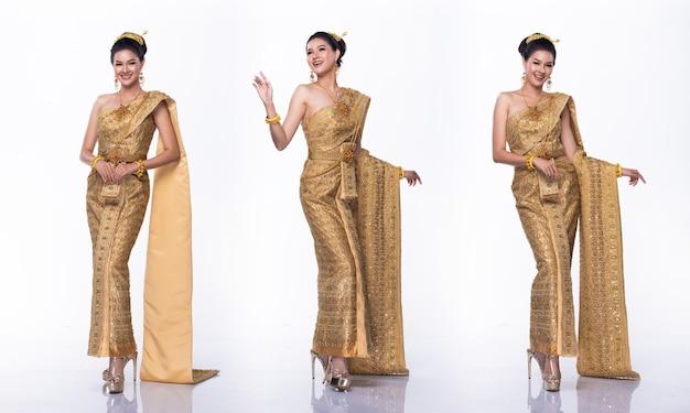 Retrato del concurso de belleza miss asian pageant en vestido de traje tradicional tailandés dorado con corona de diamante ligero, fondo blanco de iluminación de estudio, paquete de grupo de collage de cuerpo entero aislado