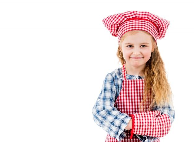 Retrato de una pequeña niña chef aislada en un backgroung blanco