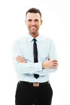 Retrato, de, sonriente, hombre de negocios, con, armamentos cruzaron