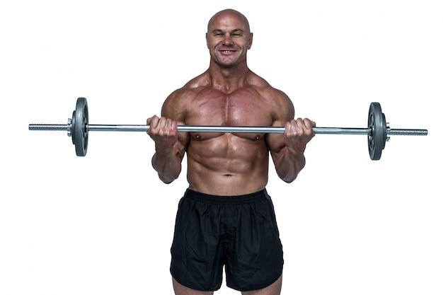 Retrato, de, sonriente, muscular, hombre, elevación, crossfit