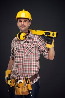 Retrato, de, sonriente, trabajador de la construcción