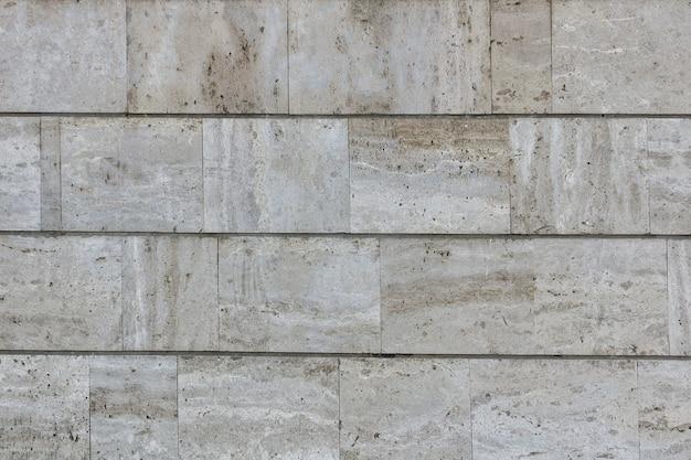 Revestimiento de pared de baldosas de mármol beige. fachada del edificio. textura de fondo de mármol