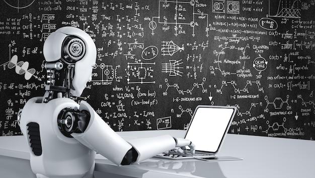 Robot humanoide usa una computadora portátil y se sienta a la mesa para estudiar ciencias de la ingeniería