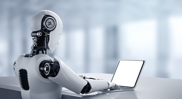 Robot humanoide usa una computadora portátil y se sienta a la mesa en la oficina futura