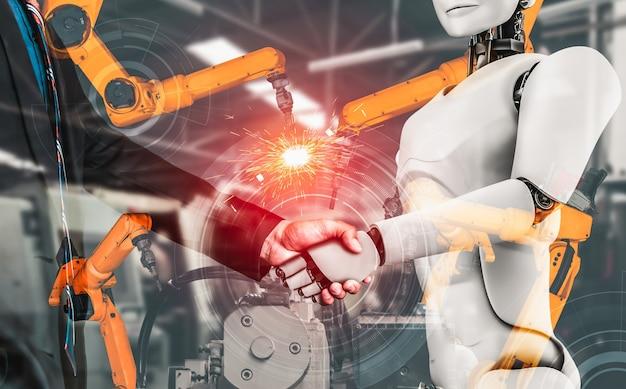 Robot industrial mecanizado y trabajador humano trabajando juntos en la futura fábrica