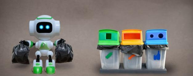 Robot mantenga la tecnología de bolsas de basura reciclar el medio ambiente sobre un fondo gris