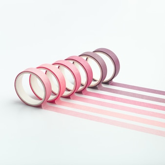 Rollos de cinta adhesiva y tiras paralelas