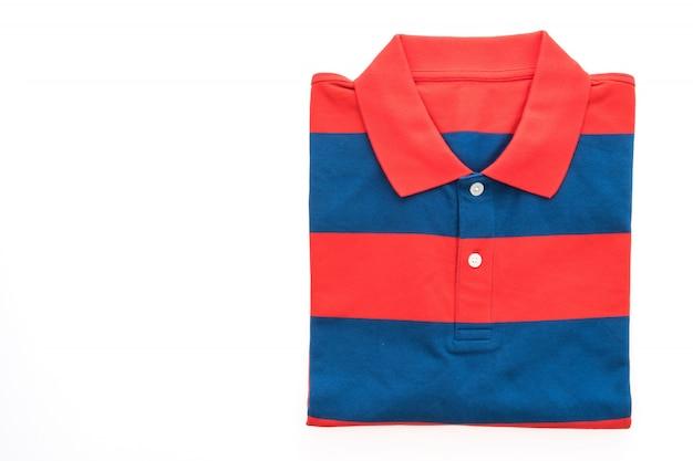 Ropa de la camisa azul joven pila