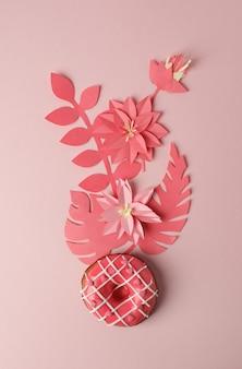 Rosquilla rosada con decoración moderna de flores de icing y origami en papel, sobre fondo rosa, monocromo