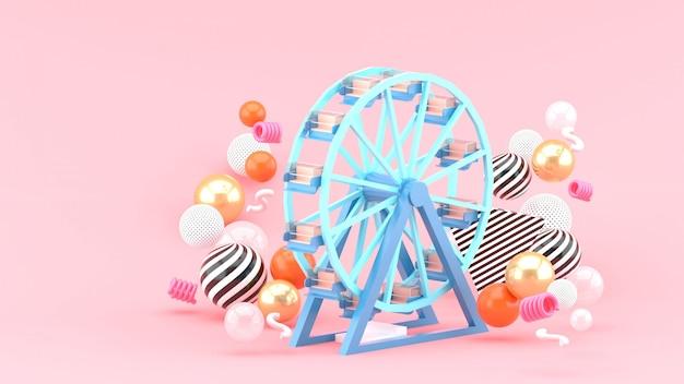 Rueda de la fortuna entre bolas de colores en un espacio rosa