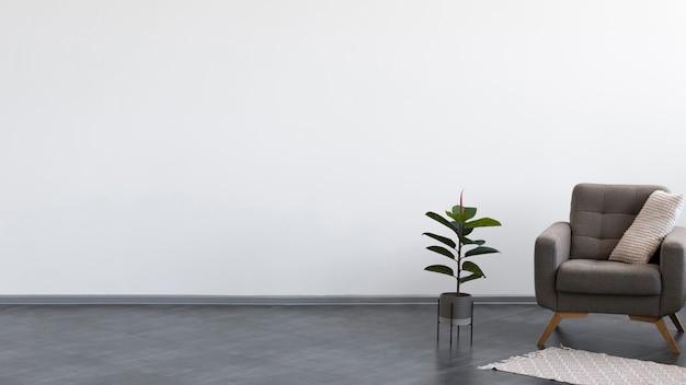 Sala de estar minimalista con sillón y planta.