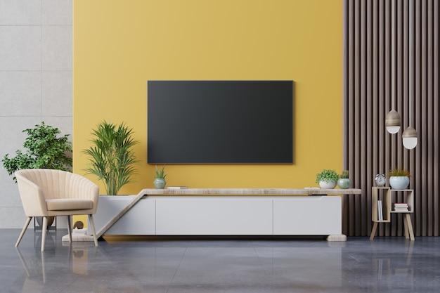 Sala de estar tv led en pared amarilla con sillón y mueble tv sobre fondo de pared amarilla, representación 3d