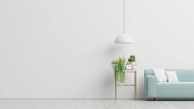 Sala de estar vacía con sofá azul, plantas y mesa sobre fondo de pared blanca vacía. representación 3d