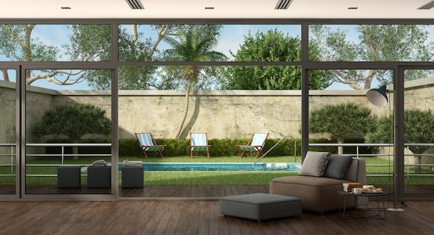 Sala de estar de una villa con piscina en el jardín.