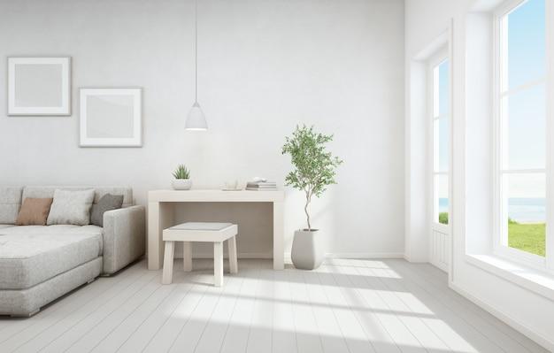 Sala de estar con vista al mar y pequeña área de trabajo de la moderna casa de playa de lujo.