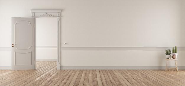 Salón blanco de estilo clásico con puerta abierta.