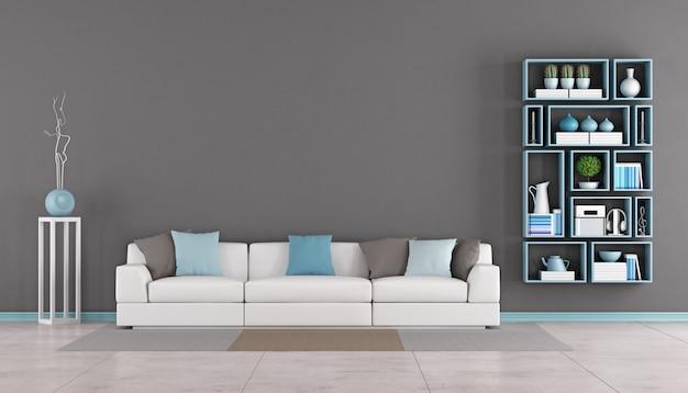 Salón contemporáneo con sofá y estantería.