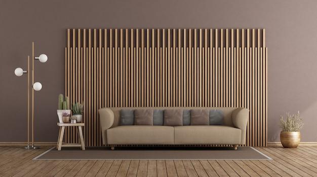 Salón con sofá y paneles de madera.