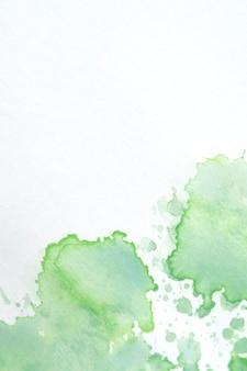 Salpicaduras de acuarela sobre textura de papel