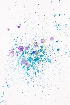 Salpicaduras de acuarela de violeta y azul