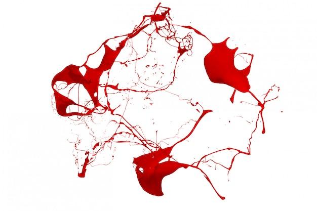 Salpicaduras de pintura roja aislado sobre fondo blanco.