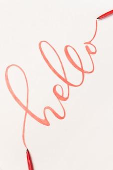 Saludo frase escrita a mano con marcador naranja