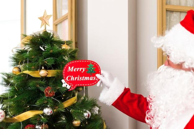 Saludo de santa claus con la navidad