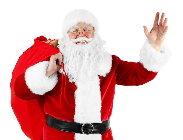 Santa claus con bolsa, cajas de regalo llenas aislado sobre fondo blanco.