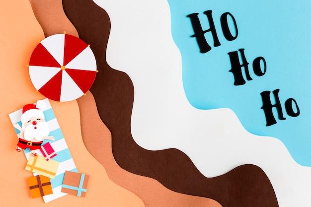 Santa en la playa vista superior estilo papel