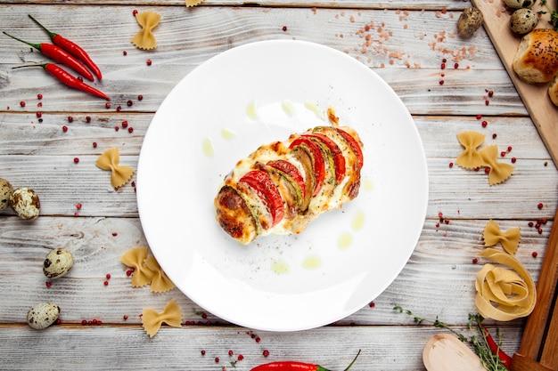 Schnitzel milán filete de pavo tomates calabacín