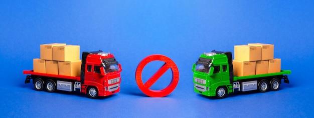 Señal de prohibición no entre dos camiones. guerras comerciales de embargo. restricción a la importación.