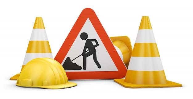 Señal de tráfico, conos y cascos.