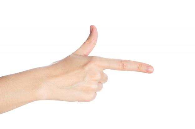 Señalando gesto. la mano femenina muestra el dedo índice sobre una superficie blanca aislada