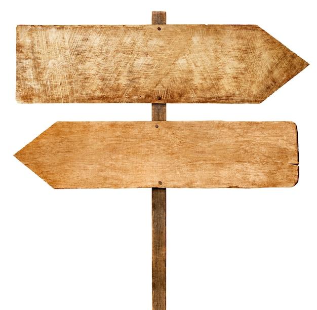 Señales de flecha de madera.