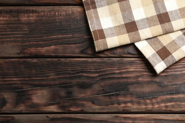 Servilletas de tela sobre fondo de madera, espacio para texto