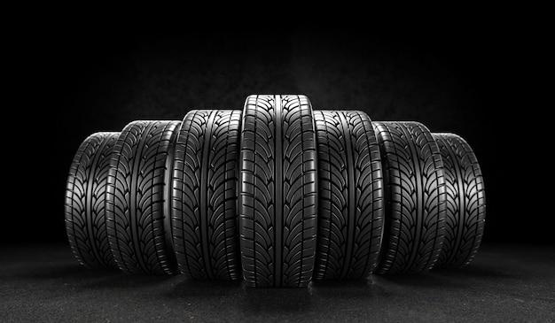 Siete ruedas de coche sobre fondo negro. representación 3d