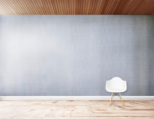 Silla blanca contra una pared gris