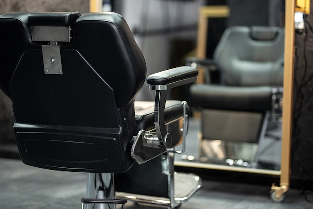 Silla de peluquería. elegante silla de barbero vintage. sillón de barbería.