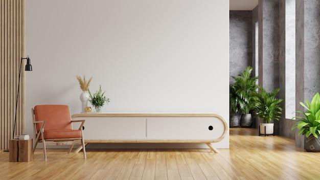 Sillón de cuero y un mueble de madera en el interior de la sala de estar con planta, pared blanca representación 3d