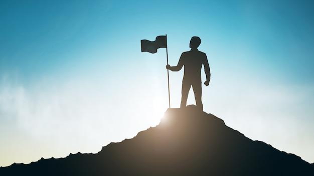 Silueta del hombre con la bandera en la cima de la montaña sobre el cielo