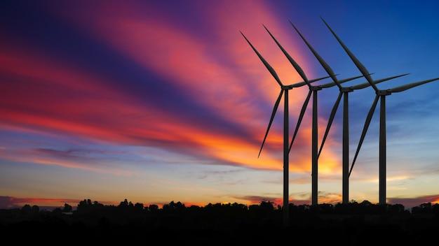 Siluetas generadores de energía de turbinas eólicas al atardecer, productos de energías renovables alternativas
