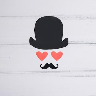 Símbolo del hombre de corazones de papel y bigote ornamental.