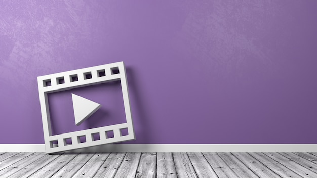 Símbolo de reproducción de película en piso de madera contra la pared
