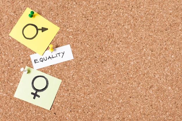 Símbolos de igualdad hombre y mujer copia espacio