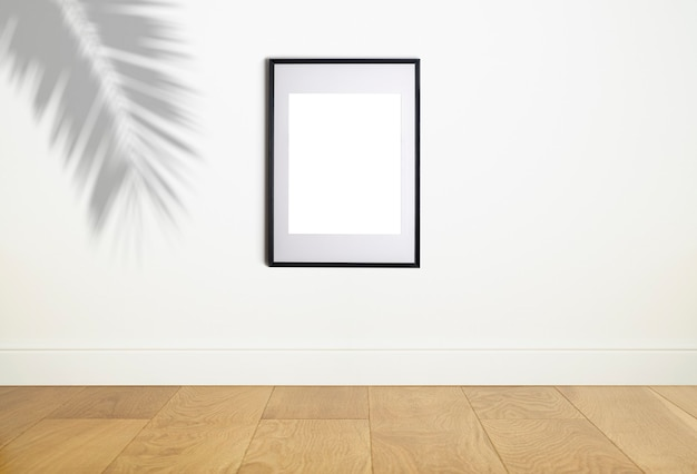 Simulacro de marco de póster en la pared blanca interior marco blanco para póster o foto