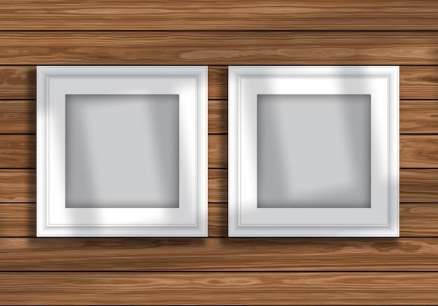 Simulacro de pantalla con marcos de cuadros en blanco en textura de madera