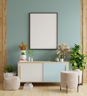 Simulacros de marco de póster en el gabinete en el interior, pared azul oscuro