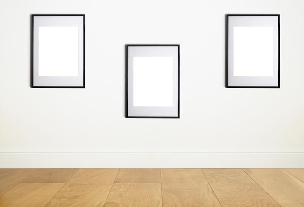 Simulacros de marco de póster en una pared blanca interior marco blanco para póster o imagen fotográfica en una pared limpia