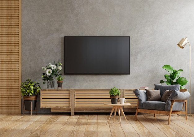 Simulacros de mueble de tv montado en la pared en una sala de cemento con sillón y mesa, renderizado 3d