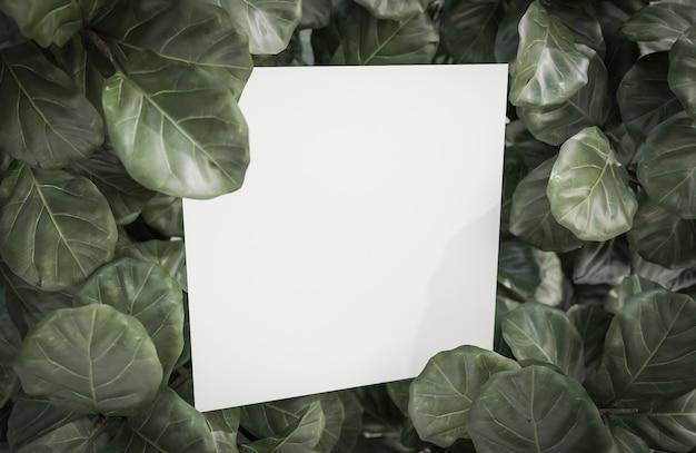 Simulacros de papel blanco sobre fondo de hoja verde tropical., modelo 3d e ilustración.